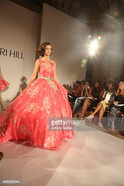 A model walks the runway during the Sherri Hill runway show during MercedesBenz Fashion Week Spring 2015 at The Plaza Hotel on September 11 in New...