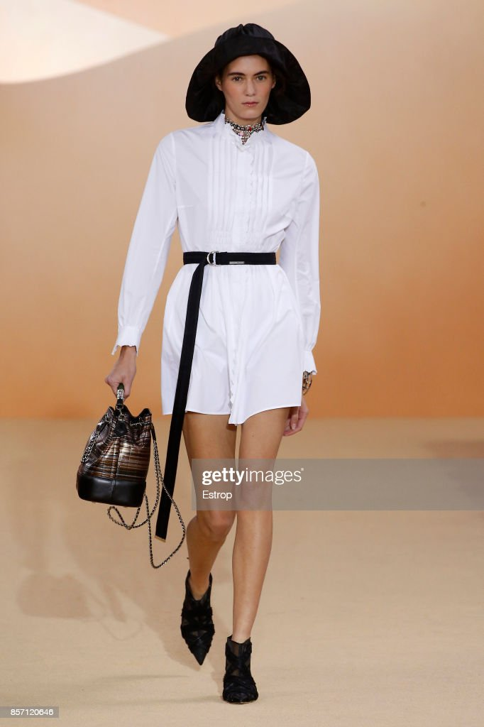 model-walks-the-runway-during-the-shiatzy-chen-paris-show-as-part-of-picture-id857120646