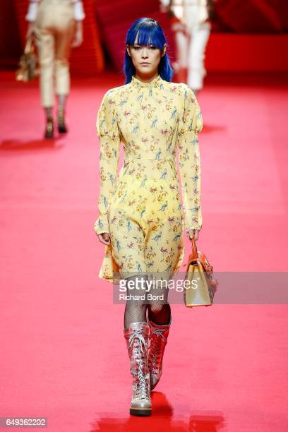 A model walks the runway during the Shiatzy Chen show during Paris Fashion Week Womenswear Fall/Winter 2017/2018 on March 7 2017 in Paris France