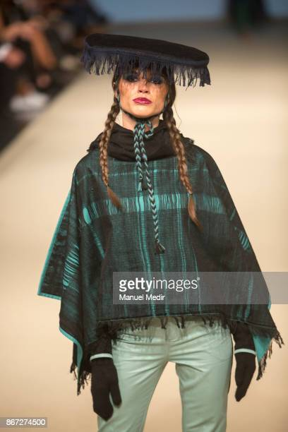 A model walks the runway during the Silvia Paredes show as part of Lima Fashion Week Spring/Summer 2017 at Gran Centro de Convenciones on October 28...