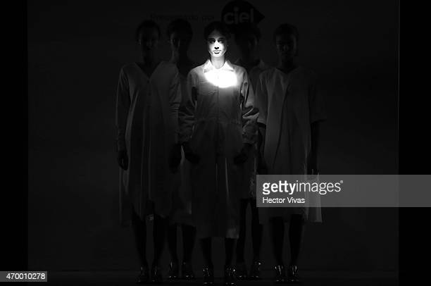 A model walks the runway during the Simple by Trista Show as part of MercedesBenz Fashion Week Mexico Fall/Winter 2015 day 3 at Campo Marte on April...