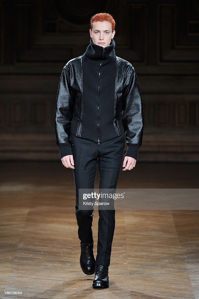 A model walks the runway during the Songzio Menswear Autumn / Winter 2013/14 show as part of Paris Fashion Week on January 19, 2013 in Paris, France.