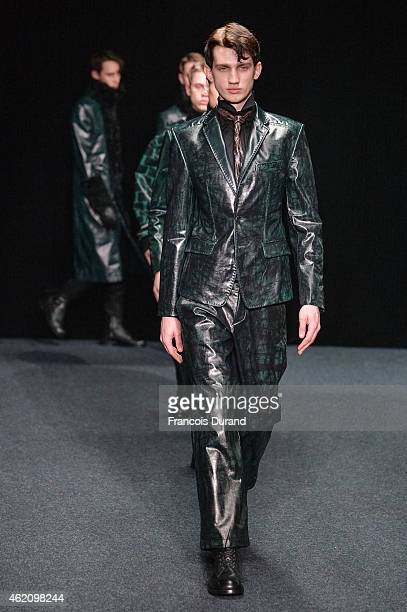 A model walks the runway during the Songzio Menswear Fall/Winter 20152016 show as part of Paris Fashion Week on January 24 2015 in Paris France