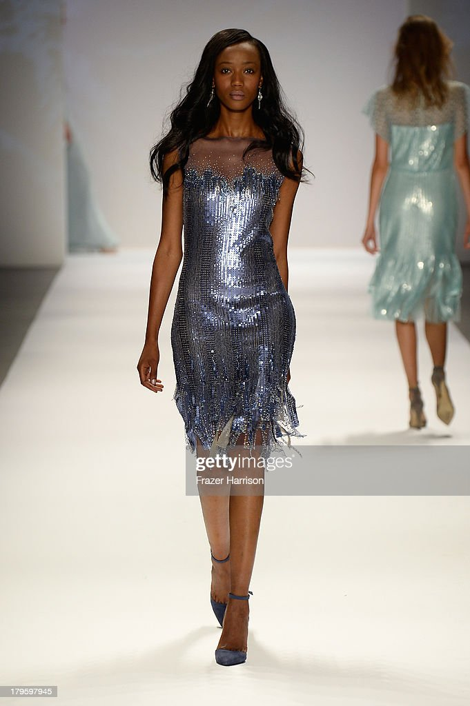 A model walks the runway during the Tadashi Shoji Spring 2014 fashion show at Mercedes-Benz Fashion Week Spring 2014 - Official Coverage - Best Of Runway Day 1 on September 5, 2013 in New York City.