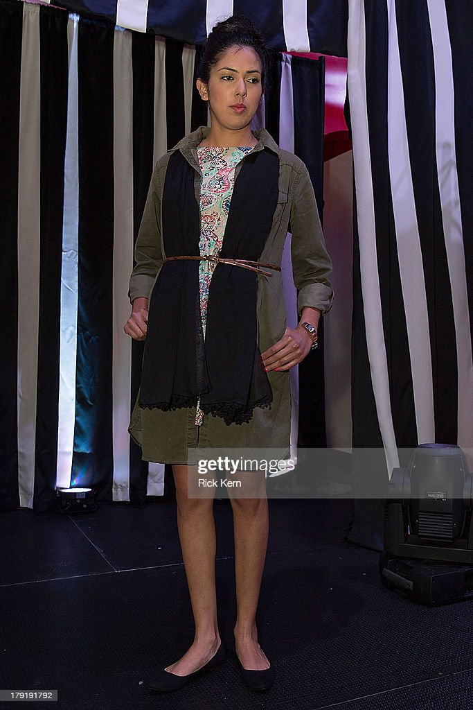 A model walks the runway during the Target Fall Fashion Runway Show at the Festival People en Español Presented by Target at the Henry B. Gonzalez Convention Center on August 31, 2013 in San Antonio, Texas.