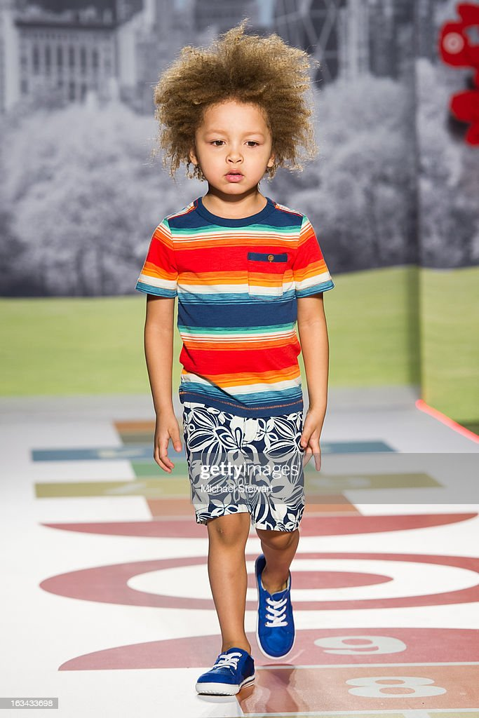 A model walks the runway during the Target fashion show at the 2013 petitePARADE Kids Fashion Week at Industria Superstudio on March 9, 2013 in New York City.