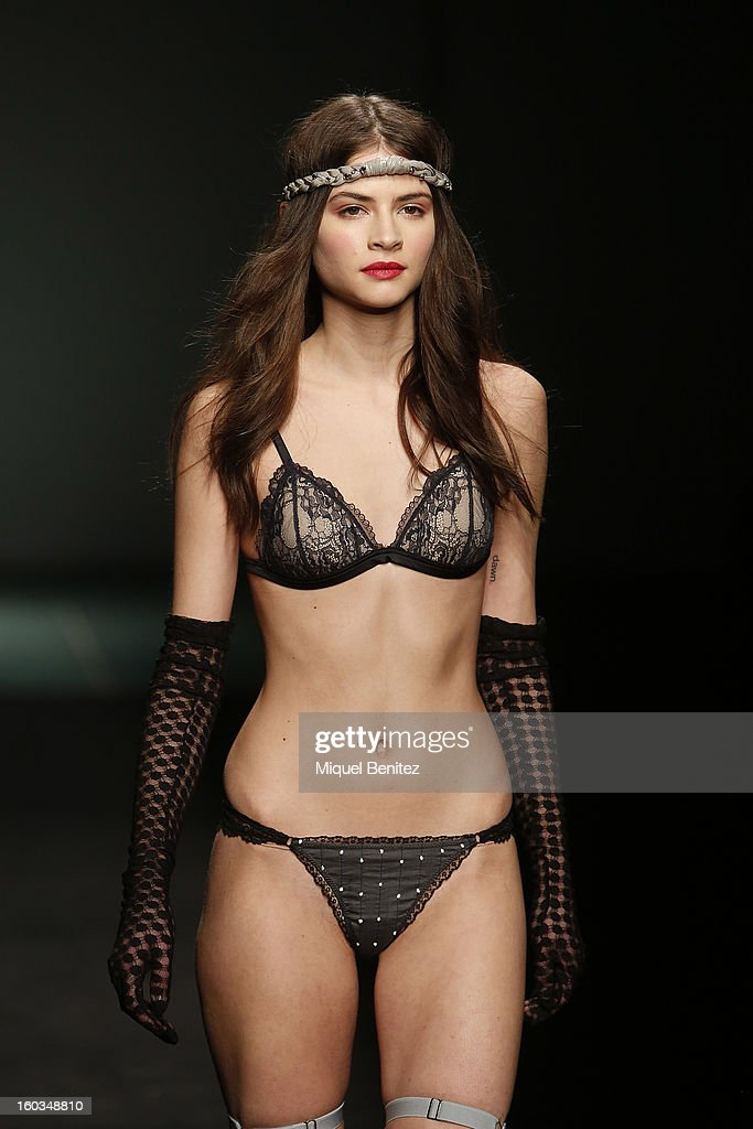 A model walks the runway during the TCN fashion show as part of the 080 Barcelona Fashion Week Autumn/Winter 2013-2014 on January 29, 2013 in Barcelona, Spain.