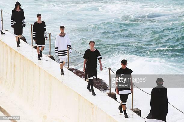 A model walks the runway during the Ten Pieces show at MercedesBenz Fashion Week Australia 2015 at Bondi Icebergs on April 16 2015 in Sydney Australia