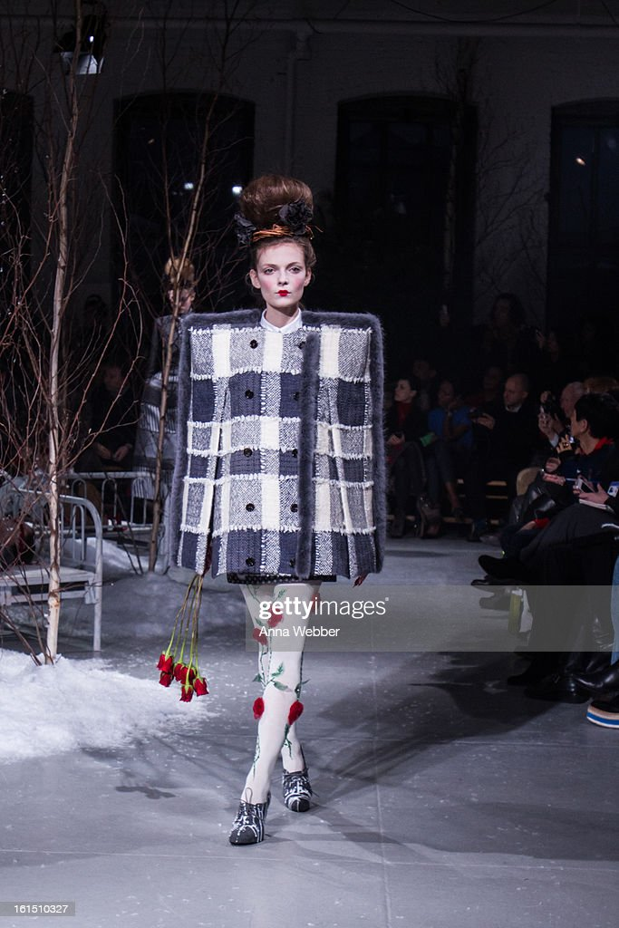 A model walks the runway during the Thom Browne fall 2013 presentation during Mercedes-Benz Fashion Week at Center 548 on February 11, 2013 in New York City.