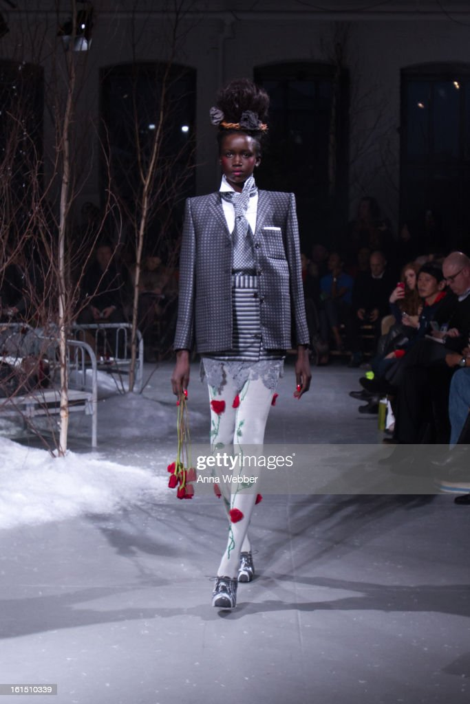 A model walks the runway during the Thom Browne fall 2013 presentation during Mercedes-Benz Fashion Week>> at Center 548 on February 11, 2013 in New York City.
