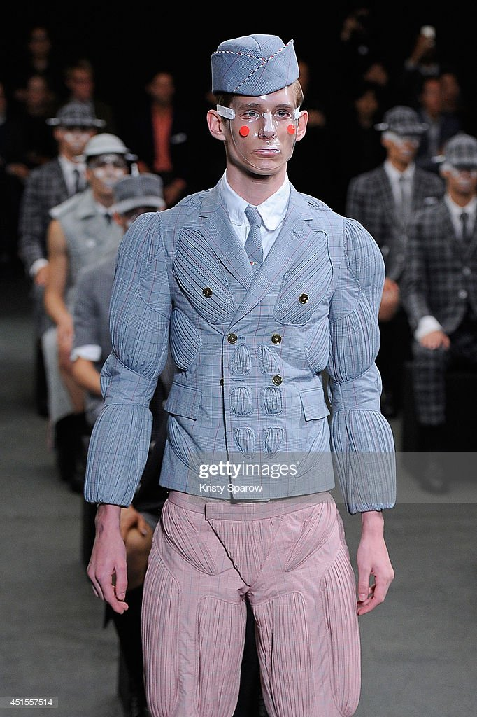 A model walks the runway during the Thom Browne show as part of Paris Fashion Week Menswear Spring/Summer 2015 on June 29, 2014 in Paris, France.