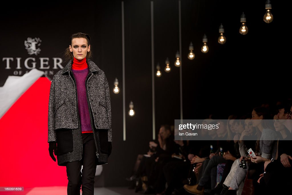 A model walks the runway during the Tiger of Sweden show at Mercedes-Benz Stockholm Fashion Week Autumn/Winter 2013 at Mercedes-Benz Fashion Pavilion on January 30, 2013 in Stockholm, Sweden.