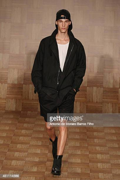 A model walks the runway during the Tillmann Lauterbach show as a part of Milan Fashion Week Menswear Spring/Summer 2015 on June 23 2014 in Milan...