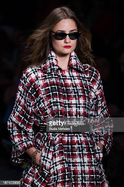 A model walks the runway during the TNG fashion show at Fashion Rio Winter 2014 at Pier Maua on November 8 2013 in Rio de Janeiro Brazil Photo by...