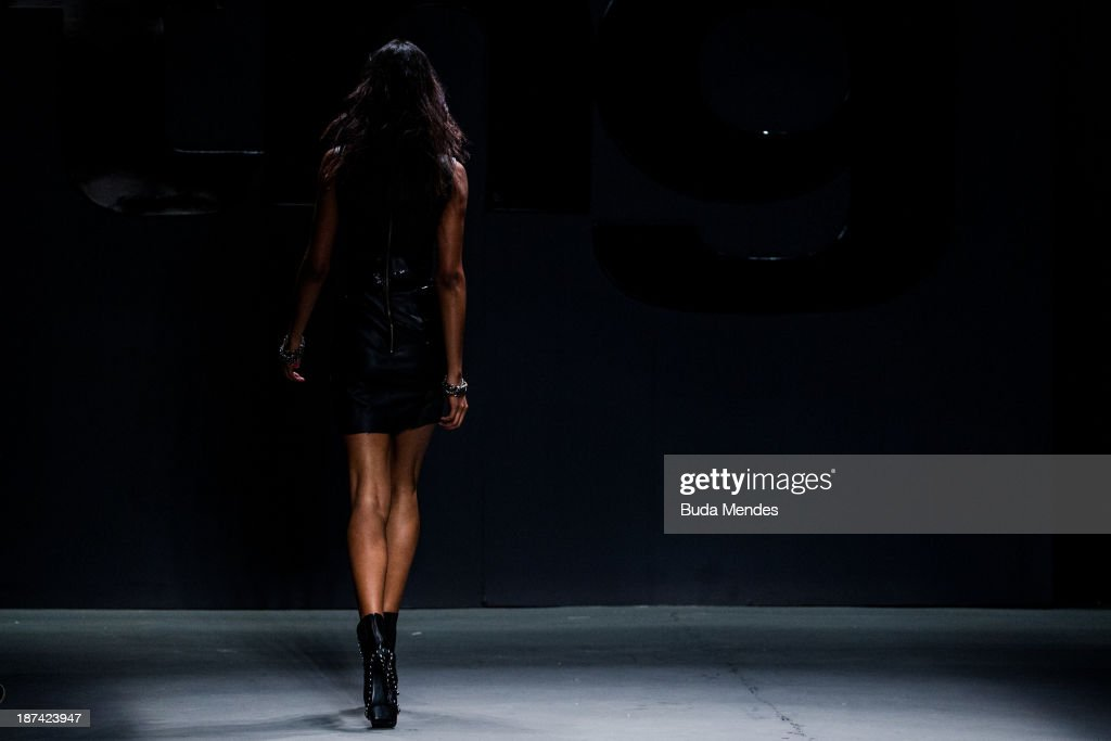 A model walks the runway during the TNG fashion show at Fashion Rio Winter 2014 at Pier Maua on November 8, 2013 in Rio de Janeiro, Brazil. Photo by Buda Mendes/Getty Images)