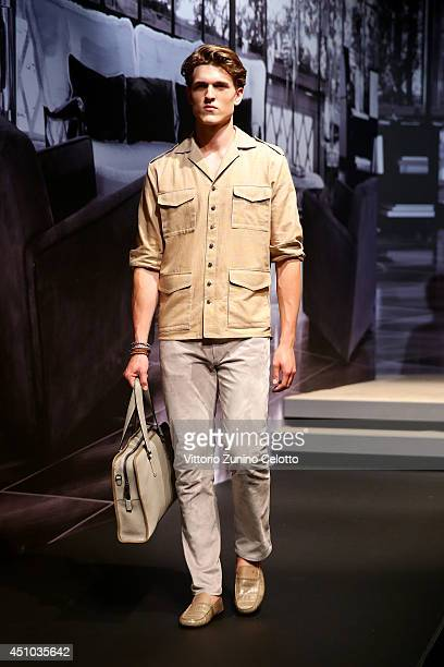 A model walks the runway during the Tod's show as part of Milan Fashion Week Menswear Spring/Summer 2015 on June 22 2014 in Milan Italy