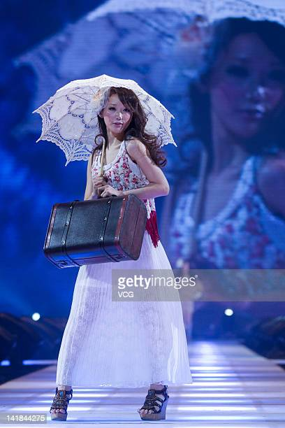 A model walks the runway during the Tokyo Girls Collection at MercedesBenz Arena on March 24 2012 in Shanghai China