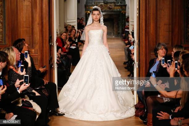 A model walks the runway during the Tony Ward show as part of Paris Fashion Week Haute Couture Spring/Summer 2014 on January 20 2014 in Paris France
