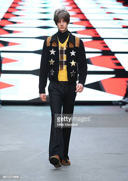 A model walks the runway during the TOPMAN Design show at the London Collections Men AW15 at The Old Sorting Office on January 9 2015 in London...