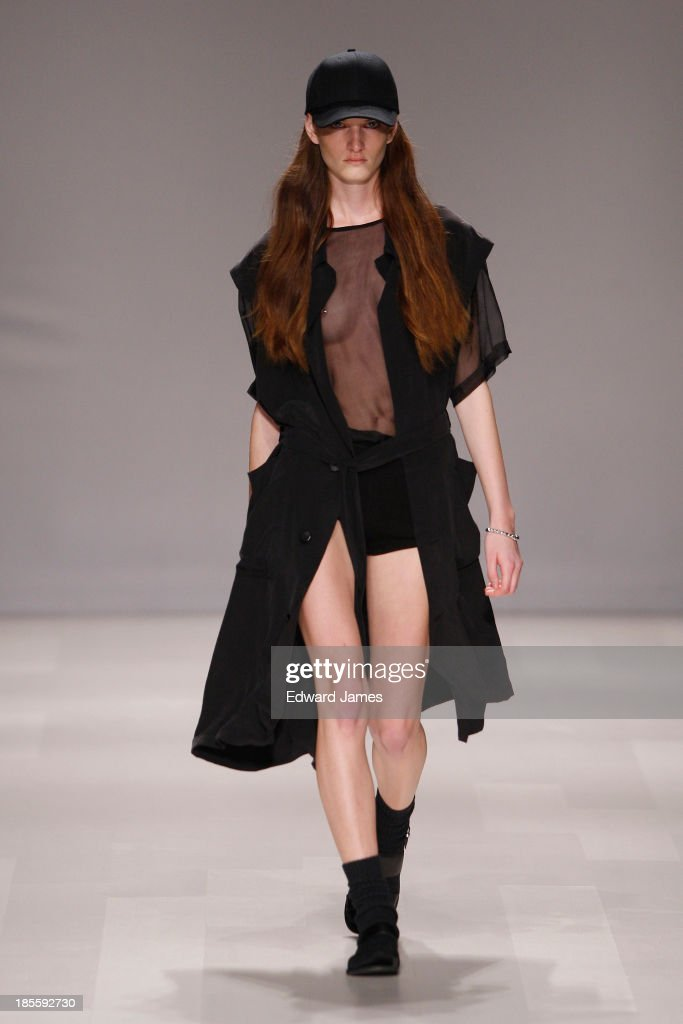 A model walks the runway during the Travis Taddeo fashion show at David Pecaut Square on October 22, 2013 in Toronto, Canada.