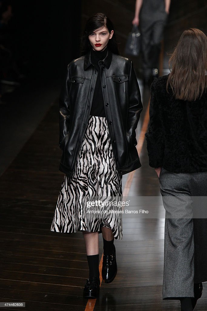 A model walks the runway during the Trussard show as a part of Milan Fashion Week Womenswear Autumn/Winter 2014 on February 23, 2014 in Milan, Italy.