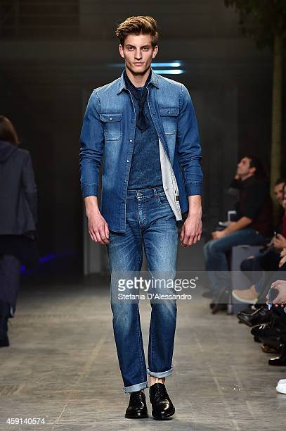A model walks the runway during the Trussardi Jeans FW 15/16 fashion show at Laboratori Ansaldo Scala on November 17 2014 in Milan Italy