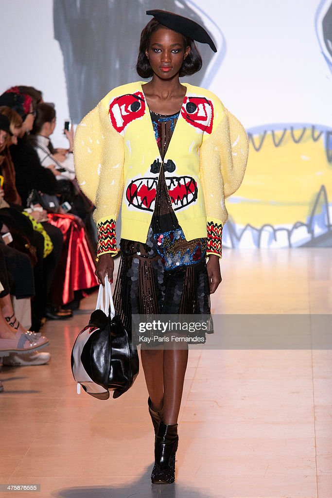 A model walks the runway during the Tsumori Chisato show as part of the Paris Fashion Week Womenswear Fall/Winter 2014-2015 on March 1, 2014 in Paris, France.