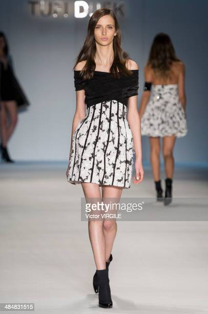 A model walks the runway during the Tufi Duek show at Sao Paulo Fashion Week Summer 2014/2015 at Parque Candido Portinari on March 31 2014 in Sao...