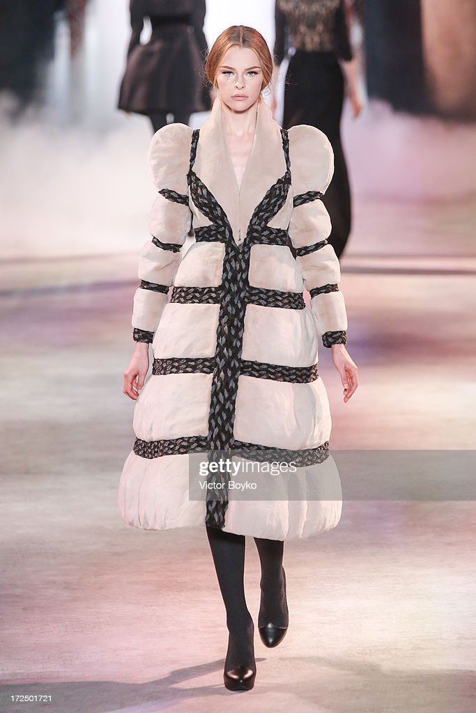 A model walks the runway during the Ulyana Sergeenko show as part of Paris Fashion Week Haute-Couture Fall/Winter 2013-2014 on July 2, 2013 in Paris, France.