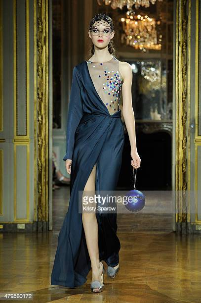 A model walks the runway during the Ulyana Sergeenko show as part of Paris Fashion Week Haute Couture Fall/Winter 2015/2016 on July 5 2015 in Paris...