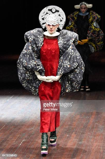 A model walks the runway during the Undercover show as part of the Paris Fashion Week Womenswear Fall/Winter 2017/2018 on March 3 2017 in Paris France