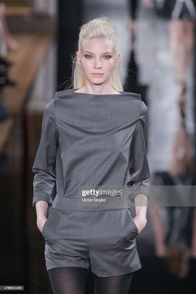A model walks the runway during the Valentin Yudashkin show as part of the Paris Fashion Week Womenswear Fall/Winter 2014-2015 on March 4, 2014 in Paris, France.