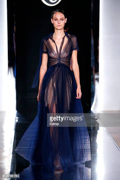 A model walks the runway during the Valentin Yudashkin show as part of the Paris Fashion Week Womenswear Spring/Summer 2017 on October 4 2016 in...