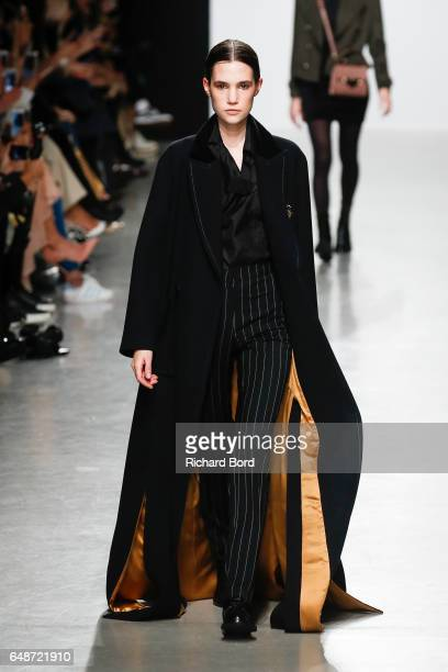 A model walks the runway during the Valentin Yudashkin show at Palais de Tokyo during Paris Fashion Week Womenswear Fall/Winter 2017/2018 on March 6...