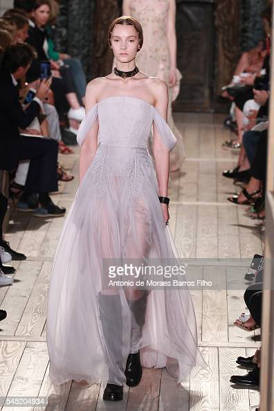 A model walks the runway during the Valentino Haute Couture Fall/Winter 20162017 show as part of Paris Fashion Week on July 6 2016 in Paris France