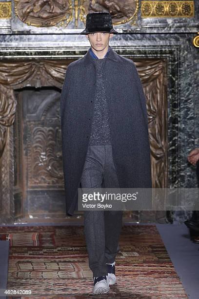 A model walks the runway during the Valentino Menswear Fall/Winter 20142015 show as part of Paris Fashion Week on January 15 2014 in Paris France