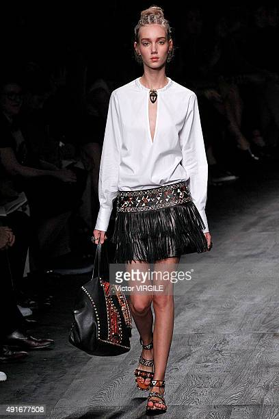 A model walks the runway during the Valentino Ready to Wear show as part of the Paris Fashion Week Womenswear Spring/Summer 2016 on October 6 2015 in...