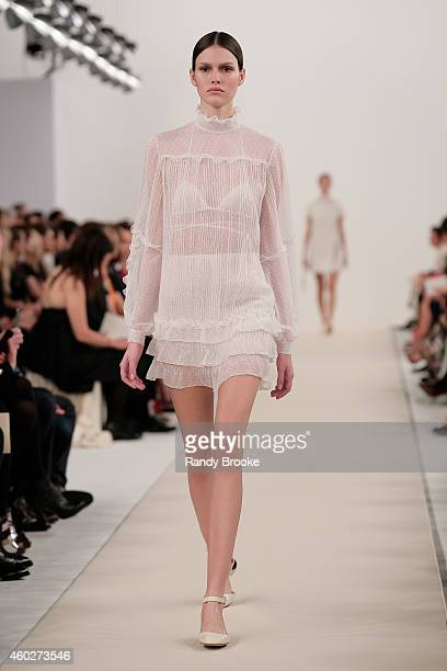 A model walks the runway during the Valentino Sala Bianca 945 Event on December 10 2014 in New York City