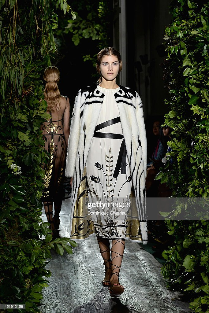 A model walks the runway during the Valentino show as part of Paris Fashion Week - Haute Couture Fall/Winter 2014-2015 at Hotel Salomon de Rothschild on July 9, 2014 in Paris, France.