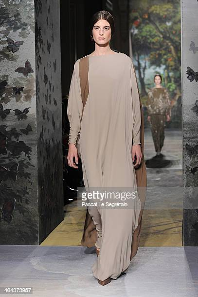 A model walks the runway during the Valentino show as part of Paris Fashion Week Haute Couture Spring/Summer 2014 on January 22 2014 in Paris France