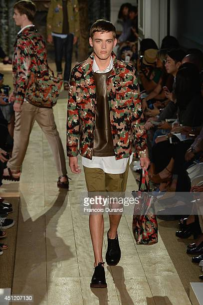A model walks the runway during the Valentino show as part of the Paris Fashion Week Menswear Spring/Summer 2015 on June 25 2014 in Paris France