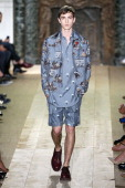 A model walks the runway during the Valentino show as part of the Paris Fashion Week Menswear Spring/Summer 2015 at Hotel Salomon de Rothschild on...