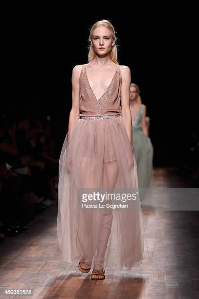 A model walks the runway during the Valentino show as part of the Paris Fashion Week Womenswear Spring/Summer 2015 on September 30 2014 in Paris...