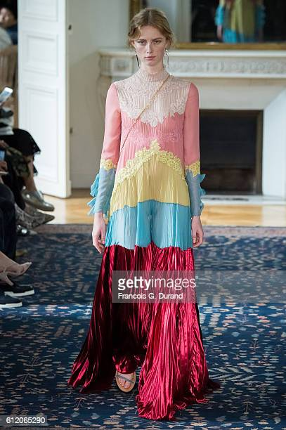 A model walks the runway during the Valentino show as part of the Paris Fashion Week Womenswear Spring/Summer 2017 on October 2 2016 in Paris France