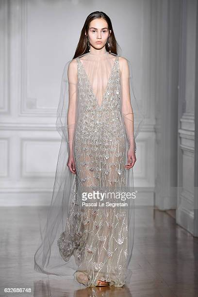 A model walks the runway during the Valentino Spring Summer 2017 show as part of Paris Fashion Week on January 25 2017 in Paris France
