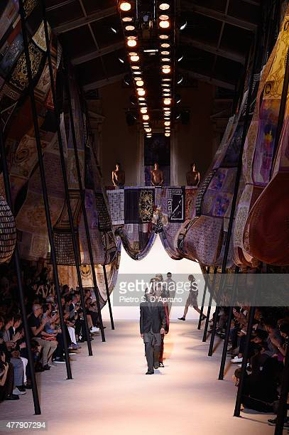 A model walks the runway during the Versace fashion show as part of Milan Men's Fashion Week Spring/Summer 2016 on June 20 2015 in Milan Italy