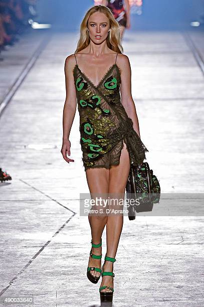 A model walks the runway during the Versace fashion show as part of Milan Fashion Week Spring/Summer 2016 on September 25 2015 in Milan Italy