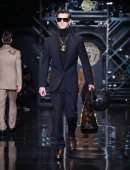 A model walks the runway during the Versace show as a part of Milan Fashion Week Menswear Autumn/Winter 2014 on January 11 2014 in Milan Italy