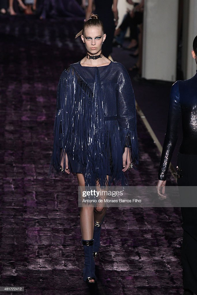 A model walks the runway during the Versace show as part of Paris Fashion Week Haute Couture Fall/Winter 20142015 at on July 6 2014 in Paris France