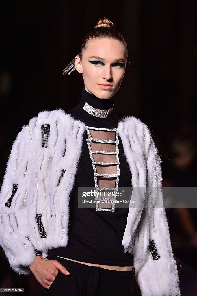 A model walks the runway during the Versace show as part of Paris Fashion Week - Haute Couture Fall/Winter 2014-2015 on July 6, 2014 in Paris, France.